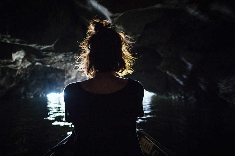 Discover a dark mysterious cave on a boat