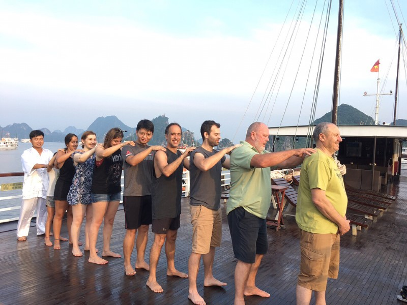 Stretching and exercising on an amazing cruise at Ha Long Bay