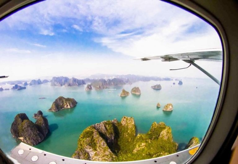 Viewing Ha Long Bay through the window of the seaplane from the sky is a 100% satisfying moment