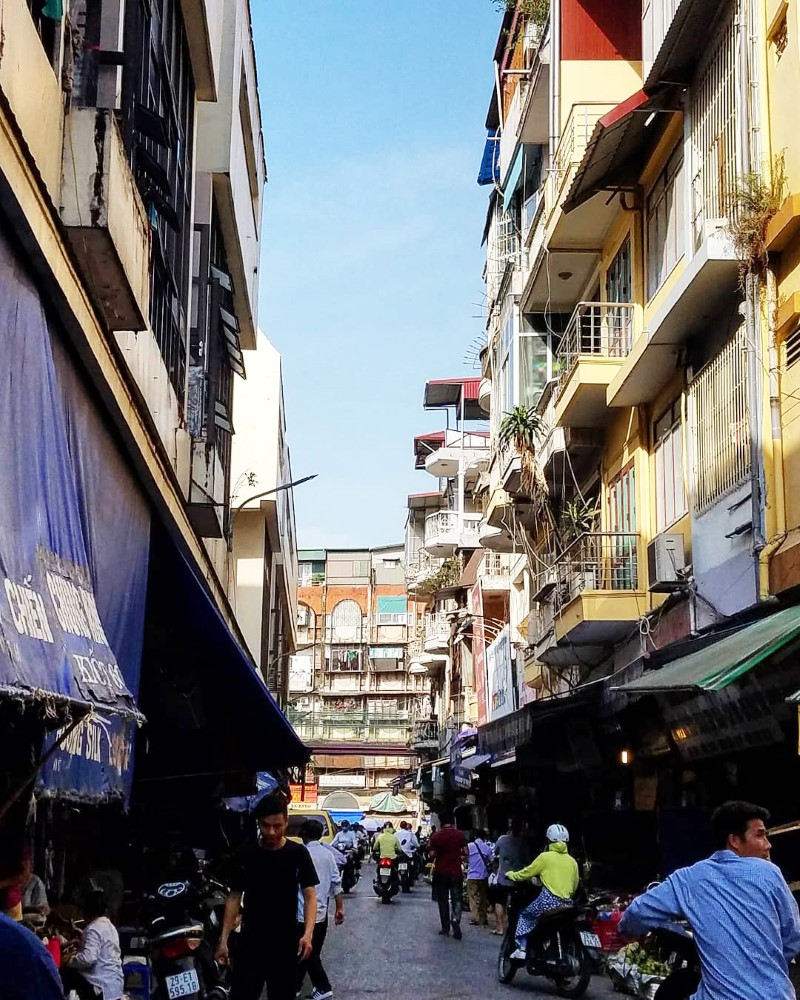 bustling alley next to Dong Xuan Market